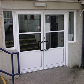 White aluminium double doors with windows either side