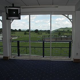 Internal view of windows looking out onto the racecourse