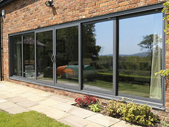 sliding doors in a residential property leading out onto a swimming pool